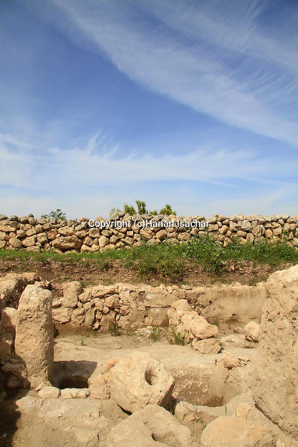 Israel, Shephelah, an ancient Olive Press at Khirbet Qeiyafa, Tel Azekah is in the background