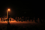 "Palestinian protesters calling themselves the ""night confusion units"", gather near the Gaza-Israel border east of central Gaza Strip, February 26, 2019. Hundreds of Palestinian protesters, have been organizing, as well as participating in night protests, during which they set tires on fire and chant slogans through loudspeakers, while marching towards the border with Israel. These protesters are also known as the ""Night Confusion"" unit. Photo by Dawoud Abo Alkas"