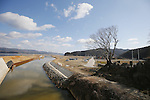 Sea defences and the remains of Okawa Elementary School on March 11, 2016 in Ishinomaki, Miyagi Prefecture, Japan. Exactly 5 years earlier 74 out of the school's 108 students lost their lives as a result of the tsunami on March 11th, 2011. There are plans to rebuild the school but as yet this has not been fixed. The fate of the destroyed buildings is also expected to be decided soon with residents of the town divided as to whether they should be preserved as a memorial or removed. (Photo by Yusuke Nakanishi/AFLO)