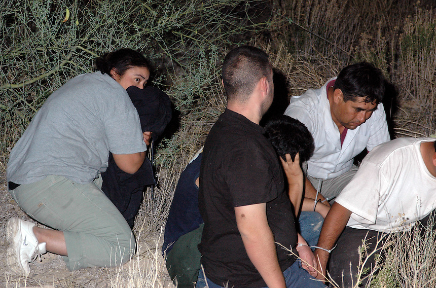 Undocumented Immigrants are detained after a chase on West Bound I-10 by the Maricopa Sheriff's Office outside of Phoenix, AZ..Photo by AJ Alexander
