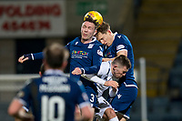 3rd March 2020; Dens Park, Dundee, Scotland; Scottish Championship Football, Dundee FC versus Alloa Athletic; Jordan McGhee and Christophe Berra of Dundee competes in the air with Kevin O'Hara of Alloa Athletic