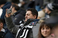6th January 2020; Allianz Stadium, Turin, Italy; Serie A Football, Juventus versus Cagliari; a supporter of Juventus takes pictures of the players - Editorial Use