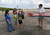 NWA Democrat-Gazette/FLIP PUTTHOFF <br /> FIRST FLIGHT<br /> Ethan Scherrey, 11, volunteers to sit up front and fly with pilot Mark Hutton (right) on Saturday June 9 2018 during the Young Eagles aviation event at Fayetteville Executive Airport. The trip was Ethan's first flight. Members of the Experimental Aircraft Association host Young Eagles events to introduce youngsters to flying and perhaps a career in aviation. Kids learn the basics of flight in a classroom session then get a free airplane ride, said Russ Smith with the association. Pilots volunteer their time and aircraft for the events, he said.