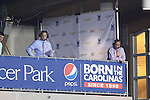 14 September 2013: Dean Linke (right) and John Bouille (left) call the game from the broadcast booth. The Carolina RailHawks played the Tampa Bay Rowdies at WakeMed Stadium in Cary, North Carolina in a North American Soccer League Fall 2013 Season regular season game. The game ended in a 2-2 tie.