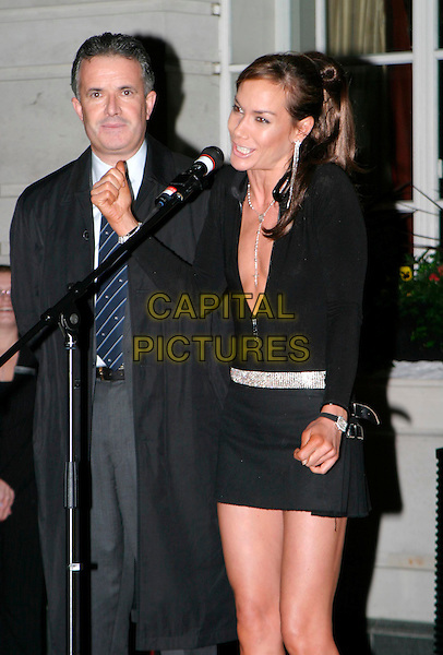TARA PALMER TOMKINSON.lights the first ever Christmas tree at the Renaissance Chancery Court hotel.19/11/2003.pleated miniskirt, kilt, plunging neckline, cleavage, diamante belt, hands, talking.www.capitalpictures.com.sales@capitalpictures.com.© Capital Pictures.