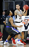 SIOUX FALLS, SD: MARCH 5: Marcus Tyus #23 of Omaha looks past IPFW defender Mo Evans #0 during the Summit League Basketball Championship on March 5, 2017 at the Denny Sanford Premier Center in Sioux Falls, SD. (Photo by Dick Carlson/Inertia)