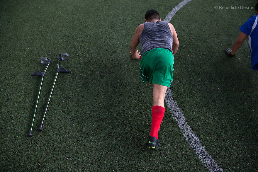 "Nesfero, a player from Guerreros Aztecas, does press-ups as part of his training in Mexico City, Mexico on June 11, 2014. Nesfero Bazan Sierra, 37, lost his left leg 20 years ago after being hit by a stray bullet while at a party. He is married, father of four children and works with the NGO World Vision. Guerreros Aztecas (""Aztec Warriors"") is Mexico City's first amputee football team. Founded in July 2013 by five volunteers, they now have 23 players, seven of them have made the national team's shortlist to represent Mexico at this year's Amputee Soccer World Cup in Sinaloa this December. The team trains twice a week for weekend games with other teams. No prostheses are used, so field players missing a lower extremity can only play using crutches. Those missing an upper extremity play as goalkeepers. The teams play six per side with unlimited substitutions. Each half lasts 25 minutes. The causes of the amputations range from accidents to medical interventions – none of which have stopped the Guerreros Aztecas from continuing to play. The players' age, backgrounds and professions cover the full sweep of Mexican society, and they are united by the will to keep their heads held high in a country where discrimination against the disabled remains widespread. (Photo by Bénédicte Desrus)"