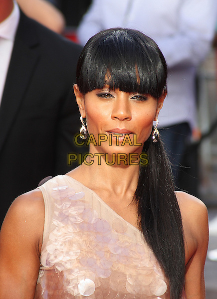 JADA PINKETT SMITH .UK Gala Film Premiere of 'The Karate Kid' at the Odeon Leicester Square, London, England, UK, July 15th 2010.portrait headshot pink beige one shoulder paillettes discs shiny fringe hair up ponytail .CAP/JIL.©Jill Mayhew/Capital Pictures