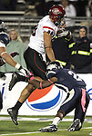 San Diego State's Gavin Escobar (88) breaks a tackle to score in overtime during an NCAA college football game in Reno, Nev., on Saturday, Oct. 20, 2012. San Diego State defeated Nevada 39-38 in overtime. (AP Photo/Cathleen Allison)