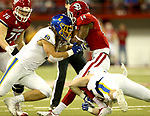 VERMILLION, SD - NOVEMBER 18: Christian Rozeboom #2 from South Dakota State University brings down Michael Fredrick #14 from the University of South Dakota during their game Saturday afternoon at the DakotaDome in Vermillion. (Photo by Dave Eggen/Inertia)