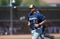 Milwaukee Brewers pitching coach Rolando Valles (26) jogs off the field after a visit to the mound during an Instructional League game against the San Diego Padres at Peoria Sports Complex on September 21, 2018 in Peoria, Arizona. (Zachary Lucy/Four Seam Images)