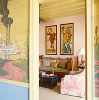 1890s lithographs hang above a 19th century daybed in the sitting room
