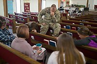 NWA Democrat-Gazette/CHARLIE KAIJO Army National Guard Specialist, Matthew Snider, of Bentonville prays during a Sunday School class on Sunday, November 12, 2017 at Monte Ne Baptist Church in Rogers. The church held a special Veterans Day color guard ceremony with special guests from the American Legion Post 100