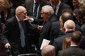 Former National Security advisor for President George H.W. Bush Brent Scowcroft, left, and former Secretary of State Henry Kissinger, center, speak together following the State Funeral for former President George H.W. Bush at the National Cathedral, Wednesday, Dec. 5, 2018, in Washington. <br /> Credit: Andrew Harnik / Pool via CNP