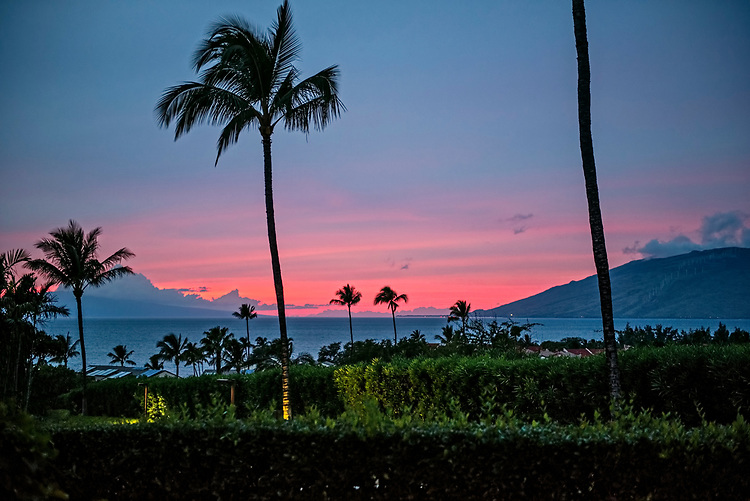 A sunset viewed from a hill above the ocean in Kihei, Maui