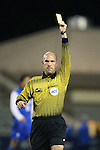 25 October 2013: Referee Brent Sorg shows a yellow card to Wake Forest's Sean Okoli (not pictured). The Duke University Blue Devils hosted the Wake Forest University Demon Deacons at Koskinen Stadium in Durham, NC in a 2013 NCAA Division I Men's Soccer match. The game ended in a 2-2 tie after two overtimes.