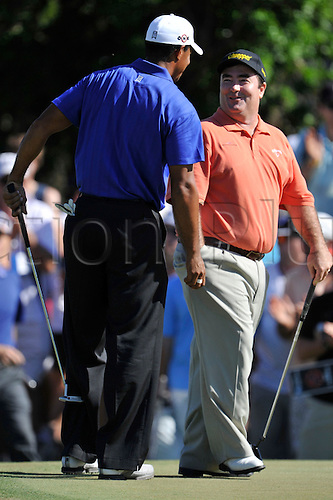 Nov 13, 2009 - Melbourne, Australia - TIGER WOODS and CRAIG PARRY find fun in between the game during the Australian Masters at Kingston Heath Golf Club. Photo: Matthew Mallett/Actionplus