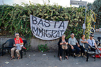 Roma 11 Ottobre 2014<br /> Manifestazione degli abitanti del quartiere Tor Sapienza, per protestare contro l&rsquo;illegalit&agrave;, i roghi tossici,i campi rom,  i nuovi centri di accoglienza per immigrati, la prostituzione e ogni altra forma di degrado.Presidio degli abitanti, contro l'apertura di un nuovo centro per gli immigrati nella ex falegnameria di via Rucellai.<br /> Rome October 11, 2014 <br /> Demostration of the inhabitants of the neighborhood Tor Sapienza to  protest against the lawlessness, the burnings toxic, Roma camps, the new reception centers for immigrants, prostitution and other forms of degradation. Presidium of the inhabitants , against the opening of a new center for immigrants in the former carpentry on via Rucellai.