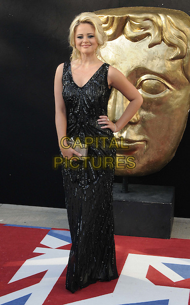 Emily Atack.Arrivals at the Arqiva British Academy Television Awards held at the Royal Festival Hall, London, England..May 27th, 2012.BAFTA BAFTAS full length black dress beads beaded clutch beg grey gray hand on hip.CAP/CAN.©Can Nguyen/Capital Pictures.