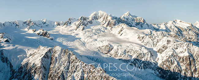 Great winter vistas of Southern Alps with Mt. Cook (3.754m) right, Mt. Tasman (3.497m) left and Fox Glacier with its vast icefields below, Westland Tai Poutini National Park, UNESCO World Heritage Area, West Coast, New Zealand, NZ