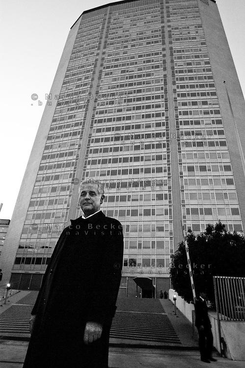 """Milano, Roberto Formigoni, Presidente della Regione Lombardia, ritratto di fronte alla sede regionale al grattacielo Pirelli,  con le luci spente per adesione alla campagna per il risparmio energetico """"M'illumino di meno"""" --- Milan, Roberto Formigoni, President of Lombardy Region, portrayed in front of the regional headquarters at Pirelli skyscraper, with lights off for joining the campaign for energy saving """"enlighten me less"""""""