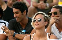 I nuotatori ed ex fidanzati Filippo Magnini e Federica Pellegrini sugli spalti al Beach Volleyball World Tour Grand Slam, Foro Italico, Roma, 21 giugno 2013.<br /> Italian swimmers Filippo Magnini and Federica Pellegrini, right, sit on the stand at the Beach Volleyball World Tour Grand Slam, Foro Italico, Rome, 21 June 2013.<br /> UPDATE IMAGES PRESS/Isabella Bonotto