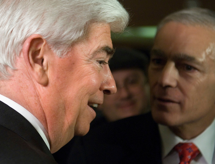 Sen. Chris Dodd, D-CT., speaks with Gen. Wesley Clark during the Democratic National Committee winter meeting at the Washington Hilton on Friday, Feb. 2, 2007.