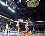 SIOUX FALLS, SD - MARCH 8: Katie Kirkhart #3 of Oral Roberts drives around Madison McKeever #23 of South Dakota at the 2020 Summit League Basketball Championship in Sioux Falls, SD. (Photo by Richard Carlson/Inertia)