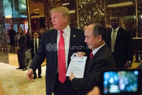 Following a meeting between the two, United States President-elect Donald Trump, left, and Son Masayoshi, CEO and founder of SoftBank,  right, speak with the press in the lobby of Trump Tower in New York, New York, USA on December 6, 2016. <br /> Credit: Albin Lohr-Jones / Pool via CNP /MediaPunch