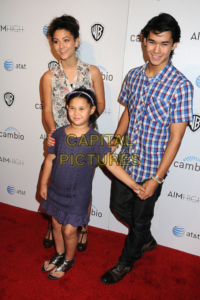 """Fivel Stewart, Sage Stewart and Boo Boo Stewart.""""Aim High"""" Los Angeles Premiere held at Trousdale, West Hollywood, California, USA..October 18th, 2011.full length top check shirt blue dress holding hands brother sisters siblings family jeans denim brown t-bar sandals white pink sleeveless hair up floral print .CAP/ADM/BP.©Byron Purvis/AdMedia/Capital Pictures."""