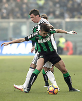 Calcio, Serie A: Sassuolo vs Juventus. Reggio Emilia, Mapei Stadium, 29 gennaio 2017. <br /> Juventus&rsquo; Mario Mandzukic, left, and Sassuolo's Luca Antei fight for the ball during the Italian Serie A football match between Sassuolo and Juventus at Reggio Emilia's Mapei stadium, 29 January 2017.<br /> UPDATE IMAGES PRESS/Isabella Bonotto