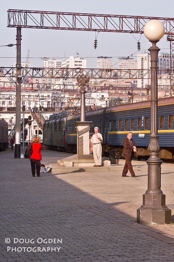 Tourists at the kilometer marker for the end of the Trans-Siberian Railroad. Vladivostok, Russia