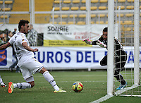BOGOTA- COLOMBIA -06 -09-2014: Victor Galain (Izq.) jugador de Fortaleza FC anota gol a Andres Castellanos (Der.) portero de Deportivo Independinete Medellin durante partido entre Fortaleza FC y Deportivo Independinete Medellin por la fecha 8 de la Liga Postobon II 2014, jugado en el Metropolitano de Techo de la ciudad de Bogota. / Victor Galain (L) player of Fortaleza FC scored a goal to Andres Castellanos (R) player of Deportivo Independinete Medellin during a match between Fortaleza FC and Deportivo Independinete Medellin for the date 8th of the Liga Postobon II 2014 at the Metropolitano de Techo Stadium in Bogota city. / Photo: VizzorImage  / Luis Ramirez / Staff.