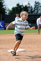 Batavia Muckdogs young fan running the bases after a game against the State College Spikes on June 30, 2013 at Dwyer Stadium in Batavia, New York.  State College defeated Batavia 7-2.  (Mike Janes/Four Seam Images)