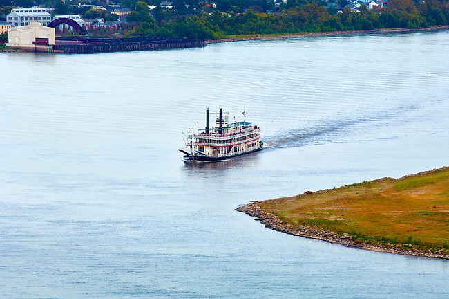 Steamboat navigates the famous crescent shaped riverbend at Algiers Point on the Lower Mississippi River toward its destination at the Port of New Orleans.