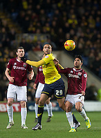 Jordan Bowery of Oxford United & Danny Rose of Northampton Town battle during the Sky Bet League 2 match between Oxford United and Northampton Town at the Kassam Stadium, Oxford, England on 16 February 2016. Photo by Andy Rowland.