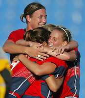 20 August 2004:  Kristine Lilly celebrates with Mia Hamm and Abby Wambach after Kristine scored a goal during the first half against Japan during the quarterfinals at Kaftanzoglio Stadium in Thessaloniki, Greece.     USA defeated Japan, 2-1 .   Credit: Michael Pimentel / ISI