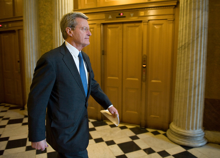 Sen. Max Baucus, D-Mont., heads to a Senate Democrats lunch in the U.S. Capitol on Thursday, March 19, 2009.