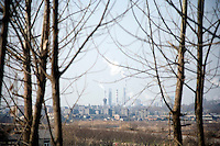A view through trees into an industrial park outside Qixia, Jiangsu, China.