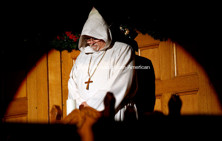 Winsted, CT- 09 January 2016-010916CM11-  Gary Storrs, plays the friar during the First Church of Winsted's 26th annual Boar's Head Festival in Winsted on Saturday. The Medieval celebration of the Epiphany, featured period costumes, live animals, the Laurel City Singers choir, a brass ensemble, pipers, dancers and drummers.  An additional seating of the festival will be held on Sunday at 3:30 p.m. with doors opening and pre-show performances one half-hour before the show time. Tickets are $9 for children 12 and under, $12 for seniors and $15 for adults.  Proceeds will benefit the Sharon Lewis Memorial Scholarship Fund and the Open Door Soup Kitchen.  Christopher Massa Republican-American