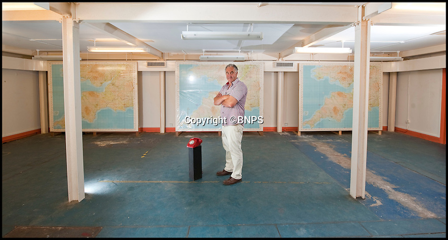 BNPS.co.uk (01202 558833)<br /> Pic: PhilYeomans/BNPS<br /> <br /> Owner Trevor Lethbridge in the vast Map room.<br /> <br /> Fed up with your neighbours...This Cold War bunker boasting 56 rooms, metre thick walls and no windows could be the perfect country retreat.<br /> <br /> The former top secret nuclear bunker on a remote Devon clifftop was built to shelter local officials in the chilling event of a Soviet strike on nearby Plymouth.<br /> <br /> The 30,000 sq ft shelter, built at the height of the Cold War in 1952, boasts heavy steel blast doors and its 375 kva generator can provide enough heat and light to keep up to 150 people safe for several months.<br /> <br /> It's 56 rooms were kitted out as bedrooms, living spaces, and mess rooms so that the administration could continue running the county even after a nuclear strike.<br /> <br /> Codenamed Hope Cove R6, it was finally decommissioned in 1999 and bought by local farmers Trevor Lethbridge and his friend Derek Brooking, who have used it as an archive storage system and a venue for charity and art events.<br /> <br /> The pair are now selling it through Clive Emson Auctioneers in Maidstone, Kent.