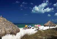 Siesta Key with white sand beach, thatched roof huts, and sunbathers, Florida's Gulf Coast. Sarasota, Florida.