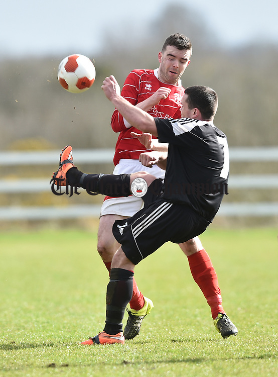 Mike Hogan of Janesboro in action against David O Grady of Newmarket Celtic during their Munster League Champions Trophy final at The County Grounds, Doora. Photograph by John Kelly.