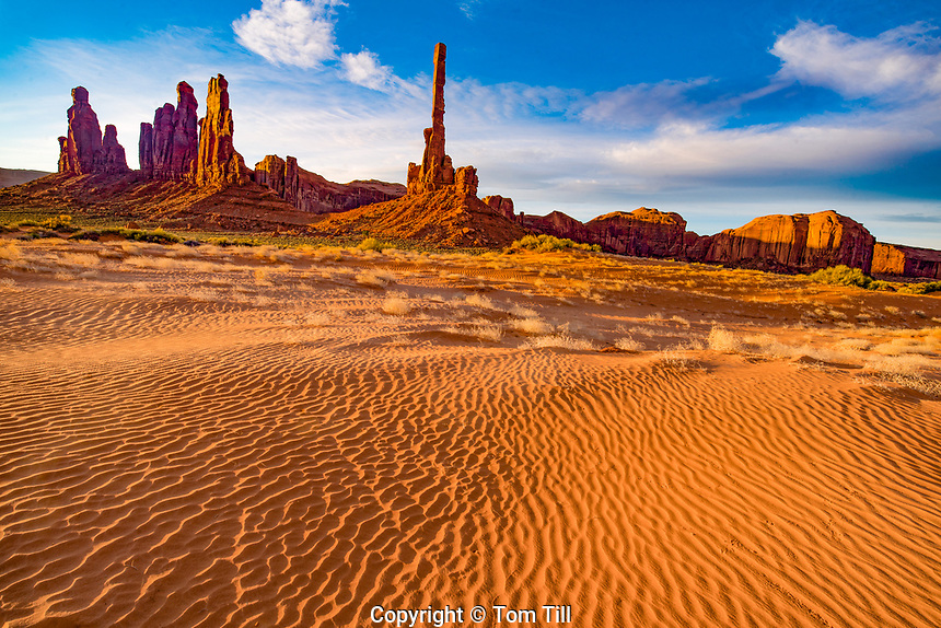 Sand dunes and the Totem Pole and Yei Bi Chei rocks, Monument Valley  Navaho Tribal Park,  Arizona