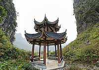 Pagoda between cliffs, Yulang River valley, Yangshuo, Guanxi, China