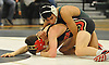 Jesse Telles of Brentwood, top, controls Brice O'Hara of Sachem East during a Suffolk County varsity wrestling meet at Brentwood High School on Friday, Jan. 8, 2016. Telles won the 106 pound match by decision 9-2. Sachem East won the meet by a score of 34-17.
