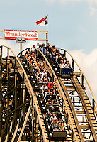 The Thunder Road wooden roller coaster is a racing coaster built in 1976 at the Carowinds theme Park near Charlotte, NC. Two individual tracks parallel each other on the racing roller coaster, which is built across the Carolinas state line. The coaster begins in South Carolina then crosses into North Carolina. The ride is part of Carowinds, a 112-acre theme park (amusement park) located on the state lines between North Carolina and South Carolina. The theme park is a popular summer Carolina attraction, one of three major theme parks in the Carolinas.