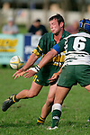 B. Farrell gets the pass away as he meets the tackle of R. Aiono. Counties Manukau Premier Club Rugby, Pukekohe v Manurewa  played at the Colin Lawrie field, on the 17th of April 2006. Manurewa won 20 - 18.