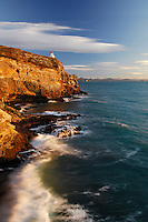 Tairoa Head Lighthouse | golden dawn light | waves | blue sky | white clouds | Otago Harbour