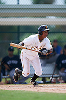 GCL Pirates outfielder Victor Fernandez (23) lays down a bunt during the first game of a doubleheader against the GCL Yankees 2 on July 31, 2015 at the Pirate City in Bradenton, Florida.  GCL Pirates defeated the GCL Yankees 2 2-1.  (Mike Janes/Four Seam Images)
